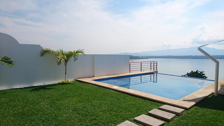 Tur stico renta casa tequesquitengo weekend cuernavaca for Alquiler de propiedades